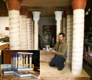 Our temple architect kneels with the scale model inside the Temple of Isis in its early stages.