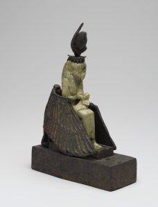 An unusual statue of Isis nursing Horus, but instead of Her wings protecting Osiris or Horus, Isis Herself is protected by the wings of Mut, the Mother Goddess in the form of a vulture. This is from Saqqara.