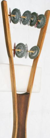 A bottle cap-type sistrum, but with carved wood instead of bamboo