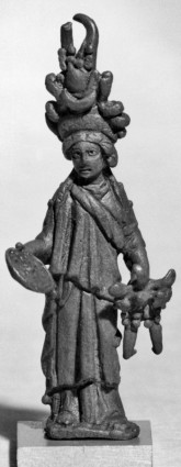 A small Roman statuette of Isis Fortuna; She's looking a bit burdened under that headdress of abundance. She also carries the Wheel of Fate and, I think, a cornucopia.