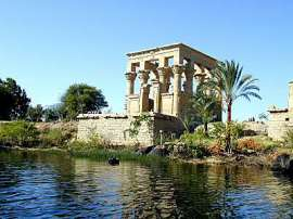The lovely Philae kiosk of the Roman Emperor Trajan in which the emperor is shown making offering to Isis and Osiris