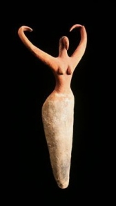 These statues are usually identified as Nile Goddesses, but she may be a dancing priestess with her arms upraised...perhaps in the Wings of Isis