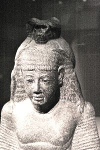 A scribe in the Kheper of Thoth (note the baboon of Thoth on his head) writing