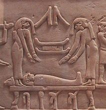 Mourners, probably Isis and Nephthys, throw Their hair over the Osiris