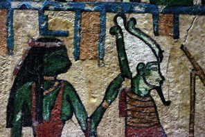 Green Isis working Her healing and protective magic on Osiris; from a stele now in the Louvre; photo by Rama; wikicommons