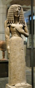 An early Greek Kore, looking very Egyptian, complete with braided wig