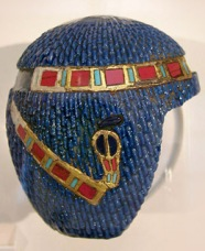 Ah look! A lapis lazuli head; 19th dynasty. This is supposed to be a wig, but not sure you could wear this...looks more like a wig for a statue