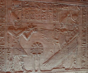 Pharaoh offers a small boat to Osiris and Isis at Her Philae Temple