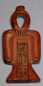 A classic Blood of Isis amulet, with the name of the deceased inscribed thereon