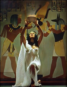 A priestess making offering; photo by Victor Keppler