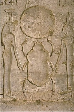 Isis and Nephthys support Khepri in the solar rebirth