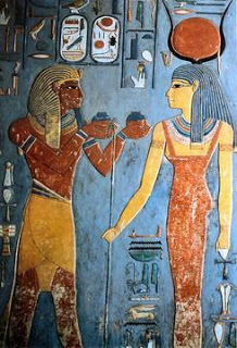 Pharaoh offering wine to Isis