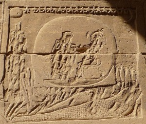 A rather destroyed image of Osiris on the back of a crocodile, Isis before them