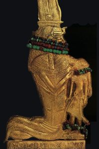 The human-headed Cobra Goddess Werethekau nursing Tutankhamum