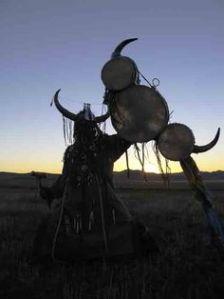 A Mongolian shaman making offering
