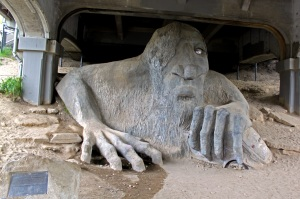 The Seattle Troll; that's a real VW Beetle in his left hand and a real bridge over his head